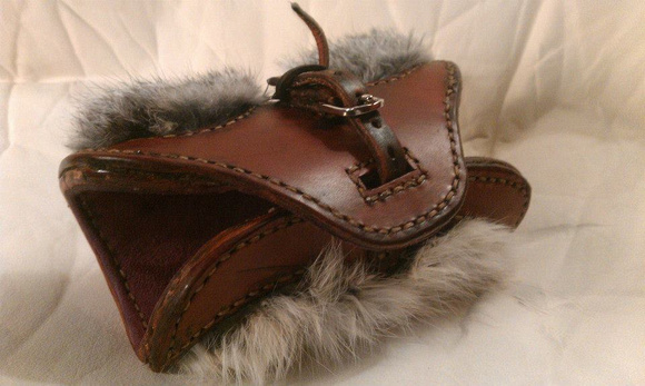 Unique Archery arm guard with rabbit fur edging and goat suede lining.