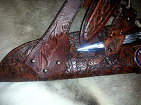 Fully carved archery quiver, incorporating double belt and bespoke engraved bag