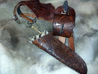 Fully carved archery quiver, incorporating double belt and bespoke engraved bag.